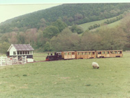 Powys and Coaches approaching the station. Notice the Signal Box
